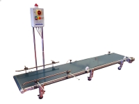 A conveyor belt with smooth PVC carpet of green, adjusters and power panel with PLC