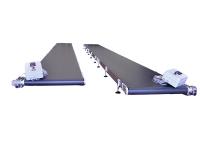 Due nastri trasportatori lunghi 9 metri, con tappeto in pvc di colore nero, completi di quadro elettrico.