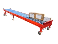 A linear roller conveyor Telescopic roller, 6 meters long, of red color, with three cardboard boxes from 2 to 30 Kg