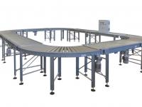 Un impianto circolare con rulliere motorizzate a rulli, curve e rettilinee, completo di impianto elettrico